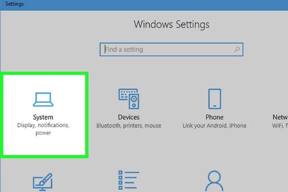 برای اتصال لپ تاپ به مانیتور روی سیستم کلیک کنید
